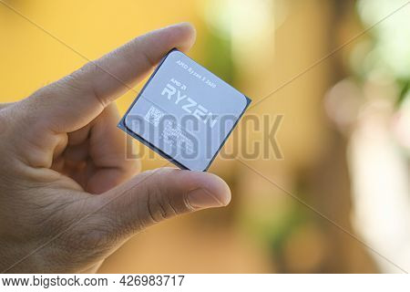 Rome, Italy - July 15 2021: Man Hand While Hold A Amd Ryzen 3600 Desktop Pc Cpu, Computer Components