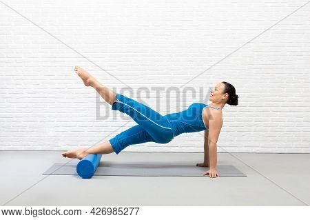 Pilates, Core And Glutes Training. Fit Caucasian Woman Practice Reverse Plank Drill With Foam Roller