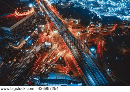 Busy Highway Road Junction In Metropolis City Center At Night . Transportation And Infrastructure Co