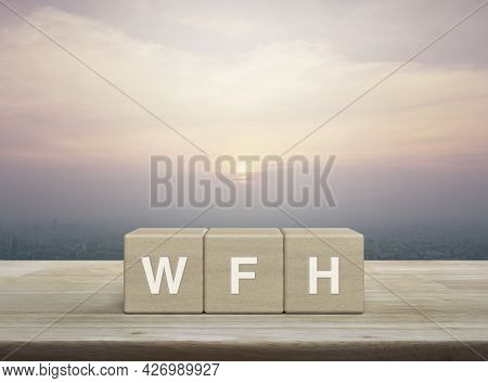 Wfh Letter On Block Cubes On Wooden Table Over City Tower And Skyscraper At Sunset, Vintage Style, B
