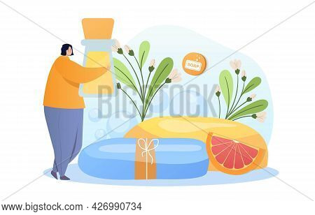 Sale Of Handmade Soap Concept. A Woman Holds A Bottle Of Liquid Soap In Her Hands And Carries It To