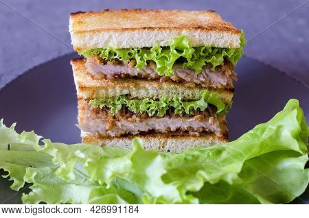 Pork Sandwich, Lettuce And Grilled Toast. Close-up, Side View