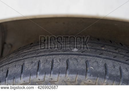 Punctured Car Tyre, Flat Tire. Nail Or Screw In The Auto Tyre.