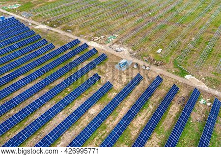 Aerial View Of Big Electric Power Plant Construction With Many Rows Of Solar Panels On Metal Frame F