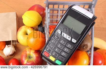 Payment Terminal, Credit Card Reader And Fresh Fruits And Vegetables With Plastic Shopping Carts, Ca