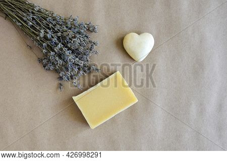 Piece Of Natural Lavender Soap, Bouquet Of Dry Lavender And Small Souvenir Heart On Craft Paper. Top