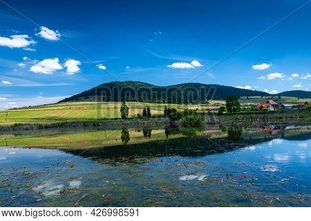 Miercurea Ciuc, Romania- 17 July 2021: Sumuleu Mountain Reflecting In A Small Pond, One F The Most V