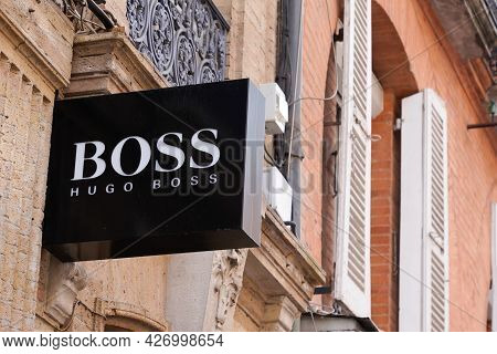 Toulouse , Occitanie France  - 06 25 2021 : Hugo Boss Shop Sign Text And Logo Brand Front Of Store O