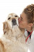Veterinary giving a kiss to a Golden Retriever after the consultation poster