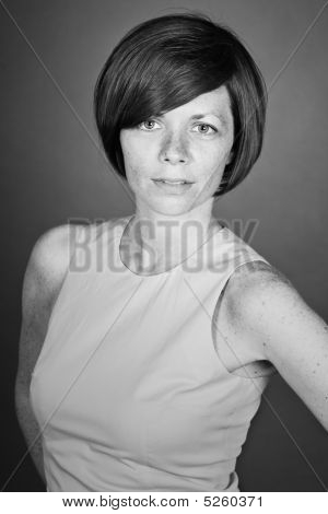 Black And White Shot Of A Pretty Brunette With Freckles