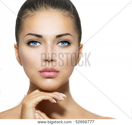 Beautiful Woman Face. Beauty Portrait. Beautiful Spa Woman Touching her Face. Perfect Fresh Skin. Pure Beauty Model Girl. Youth and Skin Care Concept. Brunette with Blue Eyes