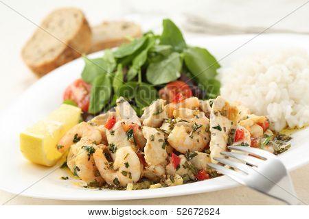 healthy dish of fried chicken and shrimps with watercress and white rice