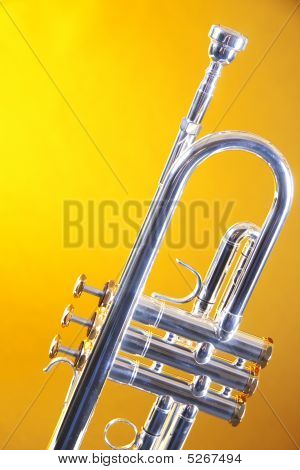 Silver Trumpet Isolated On Yellow Gold