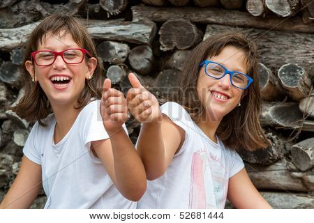 Two Handicapped Kids Doing Thumbs Up.