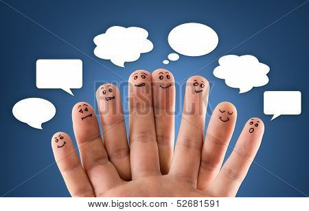 Happy Group Of Finger Smileys With Social Chat Sign And Speech Bubbles