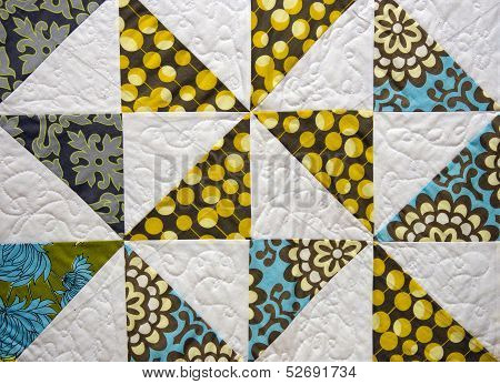 Close up of an old patchwork quilt. poster