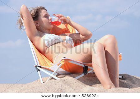 Beautifull Blond Girl In Bikini Sunbathing