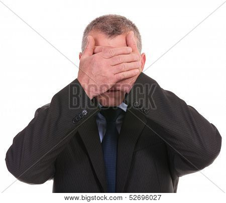 business man covering his eyes with his palms. on a white background