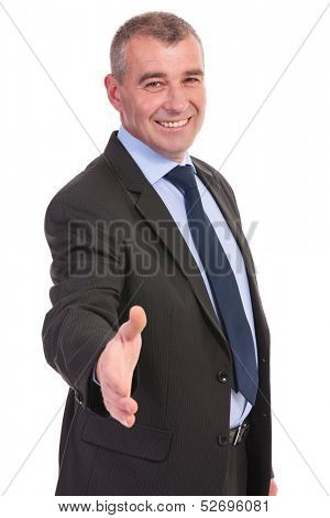 business man offering a handshake with a smile on his face. on a white background