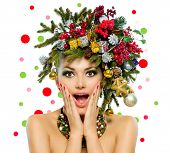 Christmas Woman. Beautiful New Year and Christmas Tree Holiday Hairstyle and Make up. Beauty Girl Portrait. Colorful Makeup, Hair, Nail polish and Accessories. Surprised Woman. Open Mouth, Emotions  poster