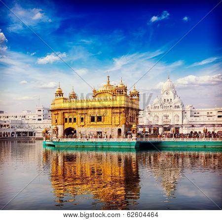 Vintage retro hipster style travel image of famous India attraction Sikh gurdwara Golden Temple (Harmandir Sahib). Amritsar, Punjab, India poster