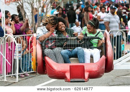 Women Laugh While Riding Carnival Ride