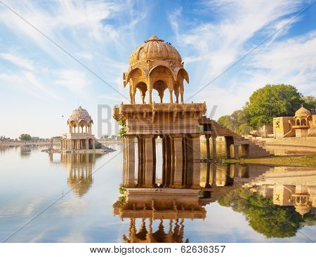 Indian landmarks - Gadi Sagar temple on Gadisar lake - Jaisalmer Rajasthan north India poster