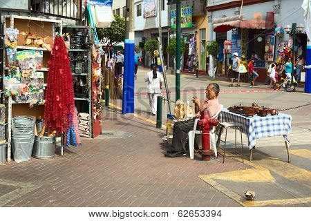 Man Selling Toys and Kitchen Utensils in Lima, Peru