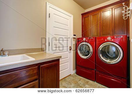 Laundry Room With Modern Red Appliances
