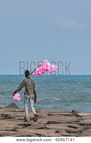 PONDICHERRY, INDIA - FEBRUARY 2, 2013: Unidentified Indian street vendor of candyfloss