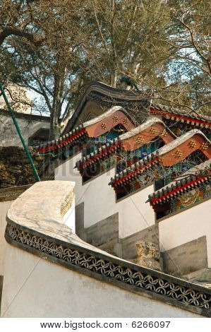 Multiple Beautiful Traditional Chinese Pavilion Roofs And Walls.