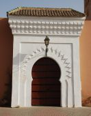 White surround to a massive wooden door on this entrance to the Koutoubia Mosque Marrakesh poster