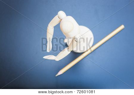 Wooden Mannequin And Pencil On Dark Background