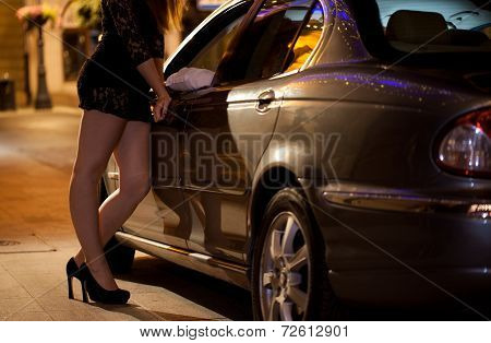 Prostitute Talking With Client