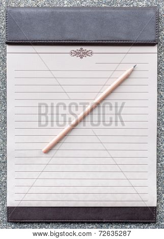 Blank Notepad With Pencil On The Brown Clipboard.