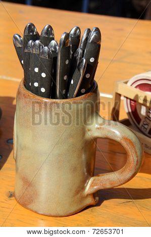 Beer mug with cutlery