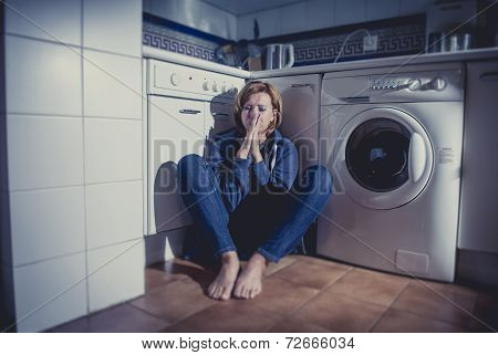 lonely depressed and sick woman sitting alone on kitchen floor in stress depression and sadness feeling miserable in barefoot looking desperate poster
