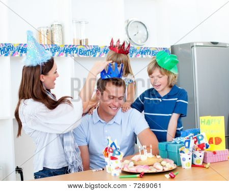 Delighted Man Celebrating His Birthday With His Wife And His Children