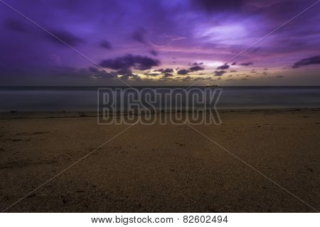 Pink and Purple Beach Sunrise With Ship On Horizon