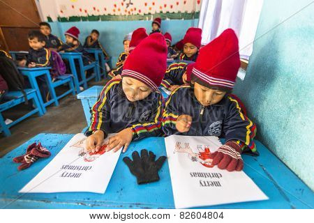 KATHMANDU, NEPAL - CIRCA DEC, 2013: Unknown pupils in English class at primary school. Only 50% of  children in Nepal can reach 5 grade.