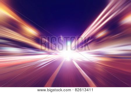 Abstract motion blurred image of night traffic in the city.