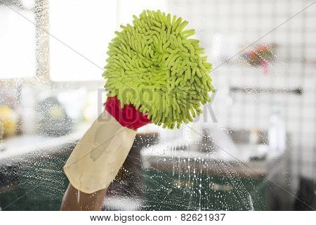 Cleaning - cleaning window pane with detergent, spring cleaning concept