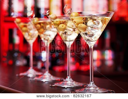 Four Martinis on a bar