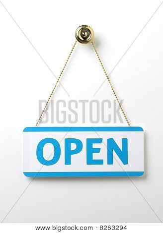 Process Blue Open Door Sign On A Brass Chain On A White Background