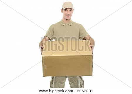 A delivery boy carrying a box