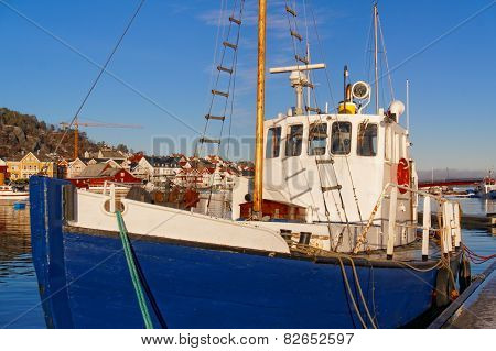 Fishing Boat With A Wooden Mast