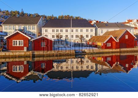 A Double Line Of Wooden Buildings, White And Red