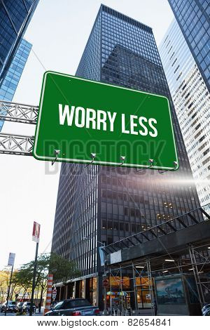 The word worry less and green billboard sign against skyscraper in city