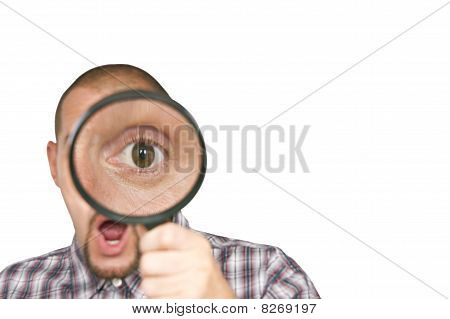 Man with magnified eye