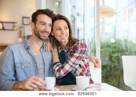 30-year-old couple sitting in coffee shop